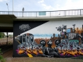 Painted during International Meeting of Styles in Wiesbaden in2009. The wall is around 6,5 meters high and 13 meter long. The image reflects warriors trying to survive in urban landscape while history is repeating itself.